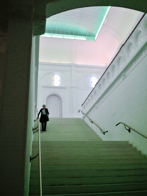 Dan Flavin neon illuminates the older entrance
